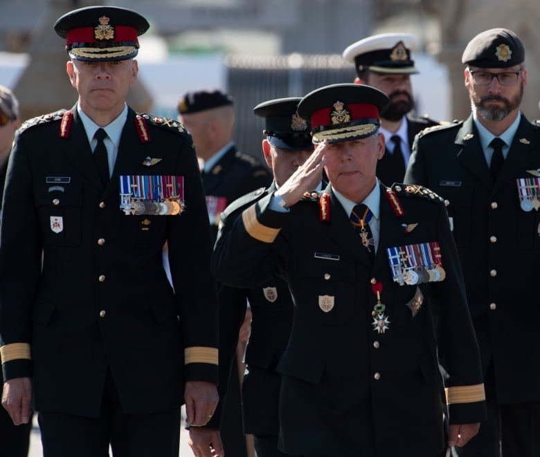 Chief of Defence Staff Jonathan Vance, right, salutes as he arrives for a change of command parade with Lt.-Gen. Wayne Eyre, left, in 2019. (Adrian Wyld/The Canadian Press)