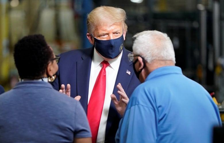Donald Trump Denies Downplaying Virus Casts Doubt On Mask Usage Cbc News