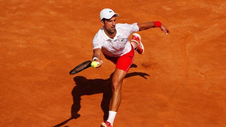 Novak Djokovic behaves better in winning 1st match since U.S. Open DQ | CBC  Sports