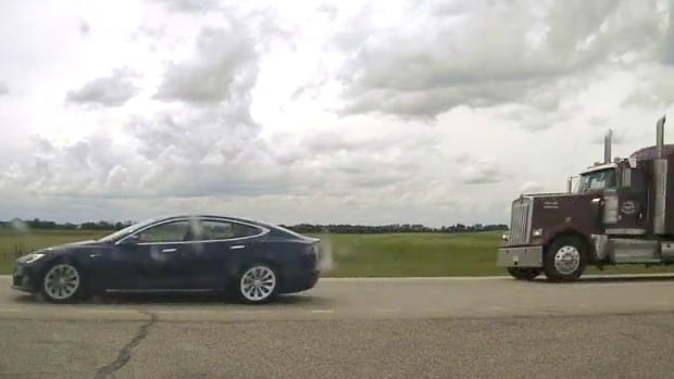 Speeding Tesla driver caught napping behind the wheel on Alberta highway | CBC News