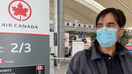 Air Canada mask airport fly Pearson