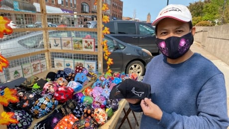 Tony Nguyen selling masks in Charlottetown