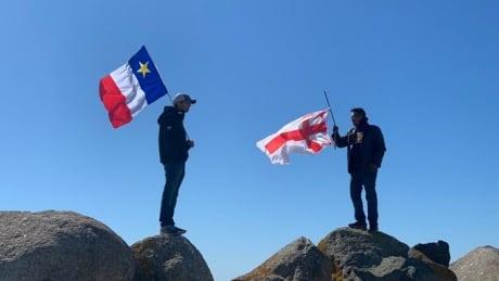 Mi'kmaw flag Acadian flag lobster fishery dispute saulnierville nova scotia