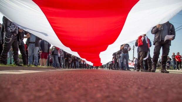 Protests, data leak keep pressure on Belarusian president to step down