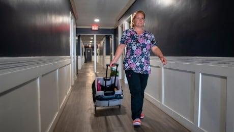 Emily Tarasoff delivering medication