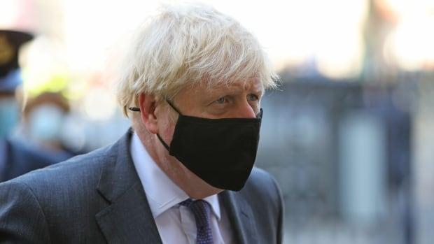 U.K. PM Boris Johnson reimposes restrictions as COVID cases surge