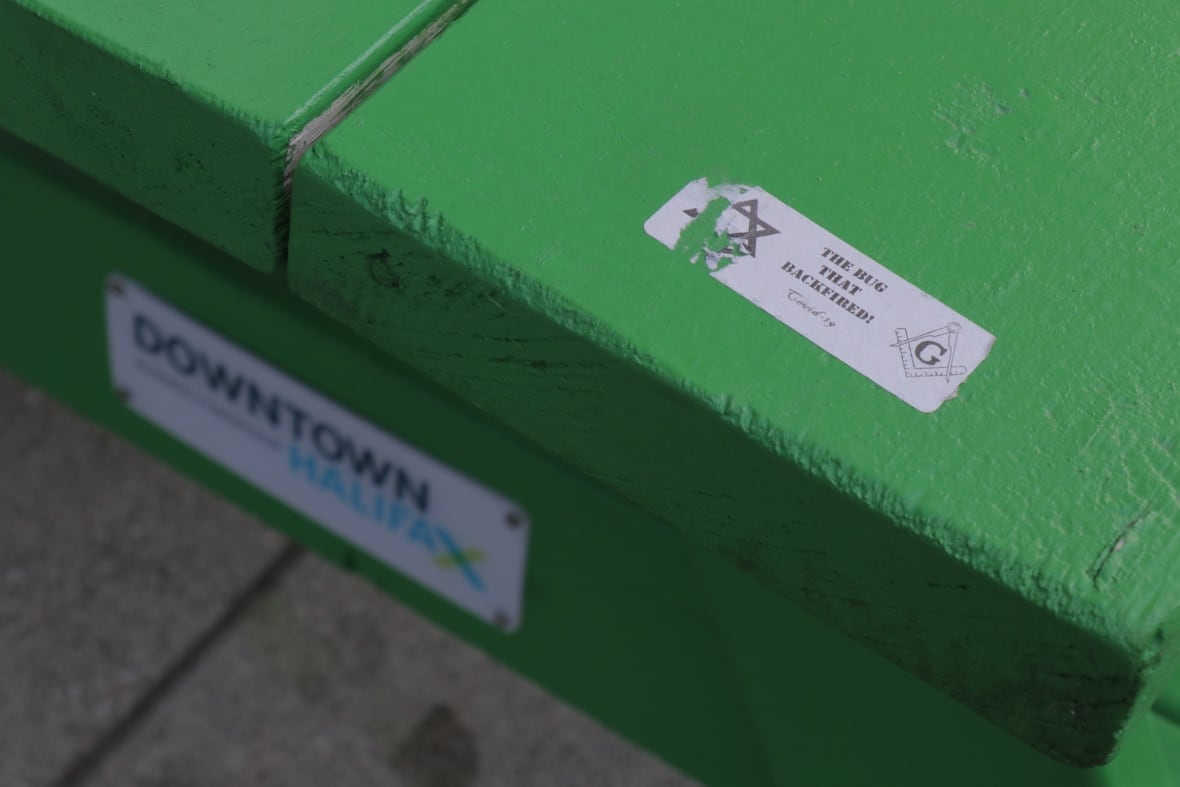 One of the stickers shown on a bench in downtown Halifax. (Jeorge Sadi/CBC)