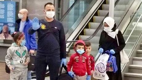 airport reunion refugee