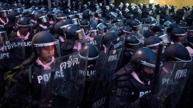Thailand bans protests as challenge to establishment escalates