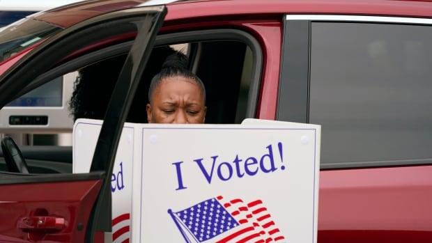 COVID puts new twist on age-old American battle over voting rights | CBC News
