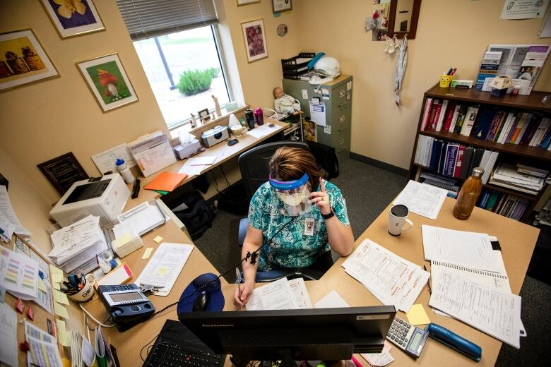 'They call us every day': COVID-19 case monitors are a lifeline for those waiting out illness at home