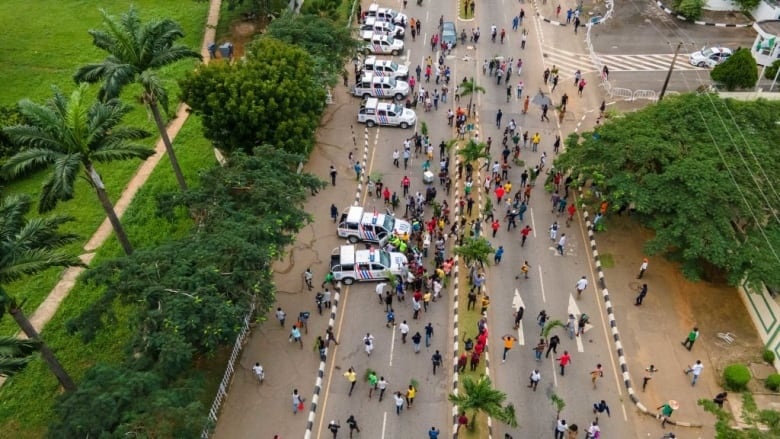 Protesters gather at the front of the Lagos State Secretariat during Tuesday's protest