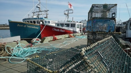 Indigenous Fishers and community around boats at Saulnierville Wharf. Wide shots of wharf. Oct 22