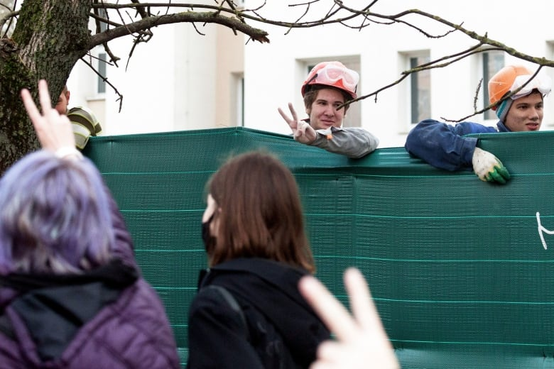 A worker flashes a V-sign in support of those striking in Minsk on Monday