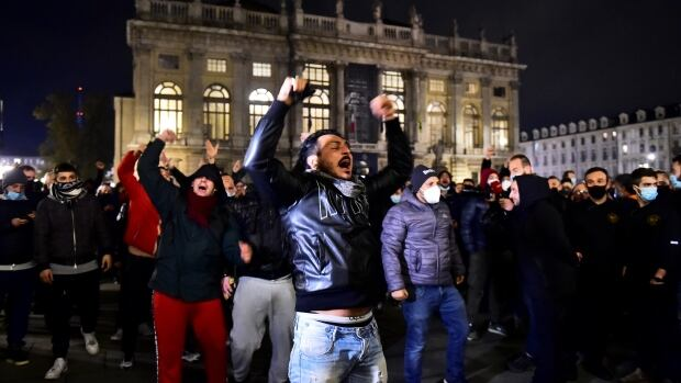 Protests flare in Italian cities over new virus restrictions | CBC News