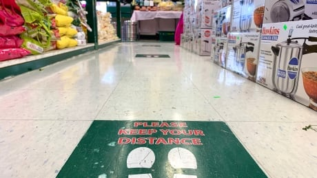 Covid supermarket floor sign