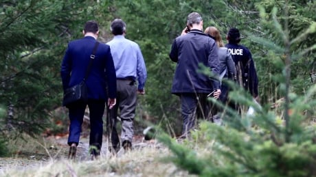 Police detectives and coroner arrive at Whiskey Creek area
