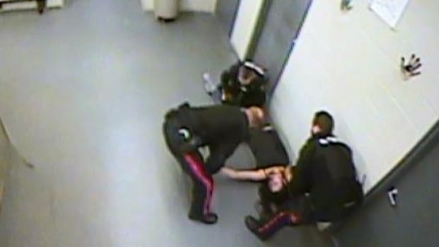 Video showing woman knocked out, dragged to RCMP cell prompts lawsuit, call for investigation