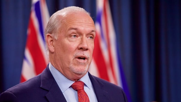 B.C. premier promises to come down 'like a ton of bricks' on COVID-19 rule-breakers
