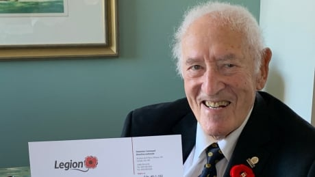 Ralph Jackson, 94, holds the long-awaited letter from the Legion readmitting him to their ranks.