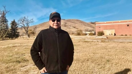 Chief Michael Starr of Starblanket stands on location of Lebret Indian Residential School