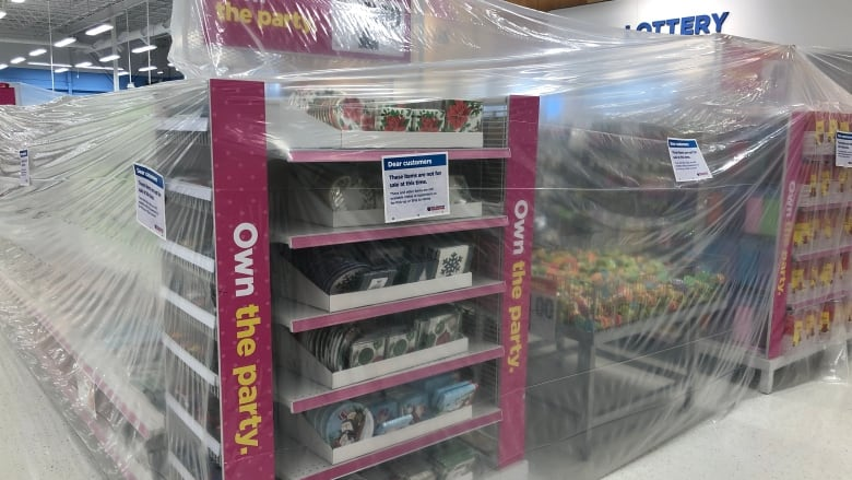 https://i.cbc.ca/1.5810295.1605901688!/fileImage/httpImage/image.JPG_gen/derivatives/16x9_780/store-shelves-taped-off-as-new-manitoba-restrictions-ban-sale-of-non-essential-items.JPG
