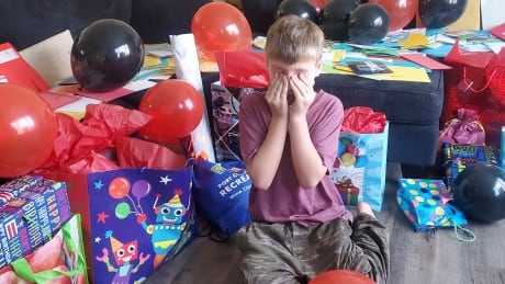 Damien Smith saw all the birthday cards and gifts in his living room