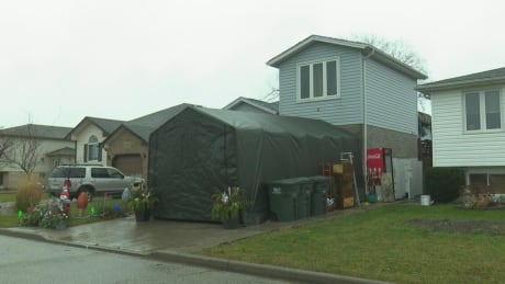 Windsor man in standoff with city over driveway tent for daughter with disability