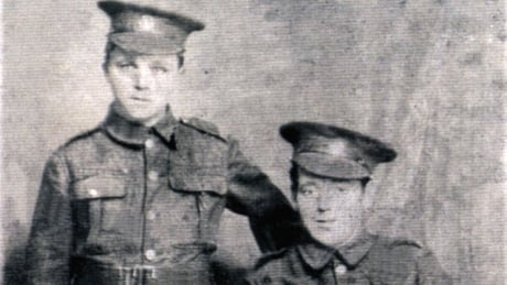 Private John Lambert (left) and an unknown soldier (right) Photo: The Coady Family