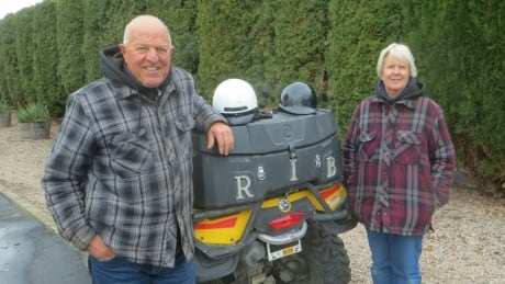 Raymond Imbeau, left, and his partner Barbara Kitz with their all-terrain vehicle