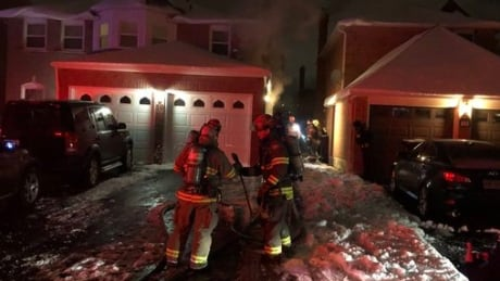 Brampton firefighters rescue woman, boy from house fire but both injured