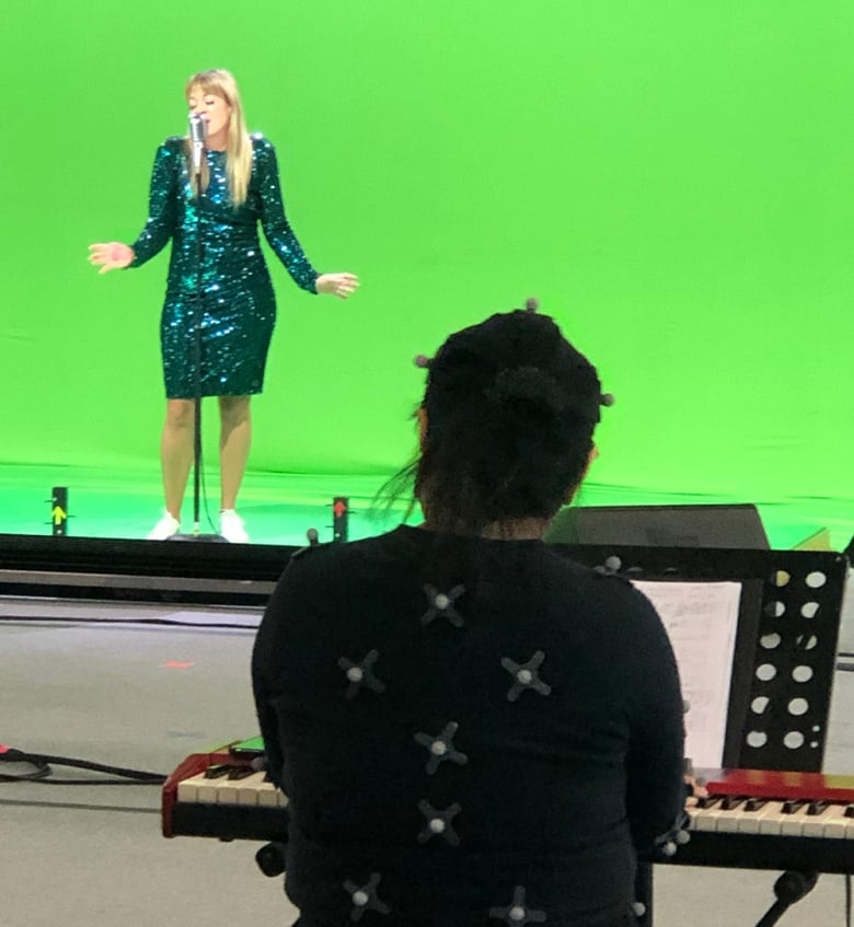 Singer's live performance in computer-generated nightclub could be a model for concerts in a COVID world