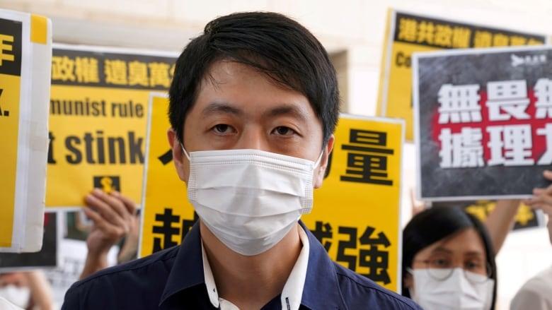 Ex-Hong Kong lawmaker says accounts frozen after he sought exile