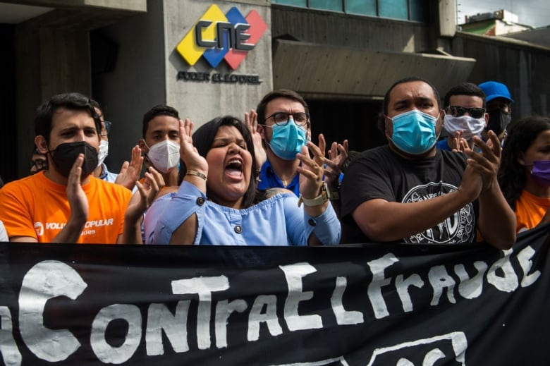 Opposition activist stage a protest, calling for a boycott of parliamentary elections, in front of the National Electoral Council headquarters in Caracas on Dec. 2. (Cristian Hernandez/AFP via Getty Images)