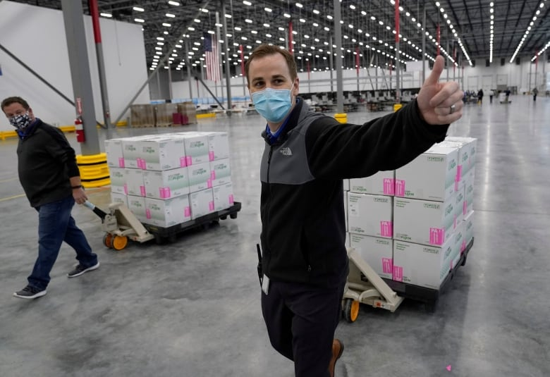 Boxes containing the Moderna COVID-19 vaccine are prepared to be shipped at a distribution centre in Olive Branch, Miss., in late December.(Paul Sancya/Reuters)