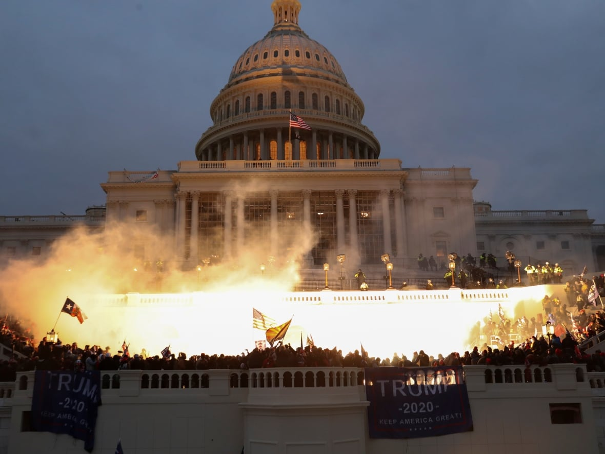 An explosion caused by a police munition is seen while supporters of U.S. President Donald Trump gather in front of the U.S. Capitol in Washington on Wednesday. Congress had been meeting to ratify president-elect Joe Biden's 306-232 electoral college win over Trump. A group of Republican senators said they would reject the electoral college votes of several states unless Congress appointed a commission to audit the election results.