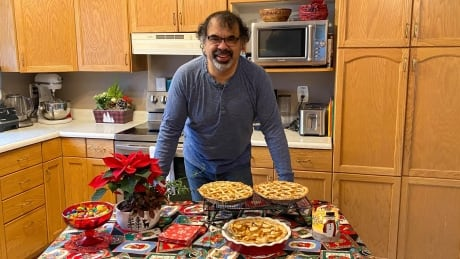 Alcide Punko with his bannock apple pies