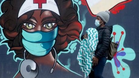 COVID Cda 20210114 pandemic mural coronavirus pedestrian