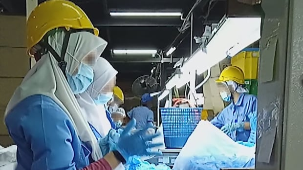 Hidden camera reveals 'appalling' conditions in overseas PPE factory supplying Canadian hospitals, expert says | CBC News