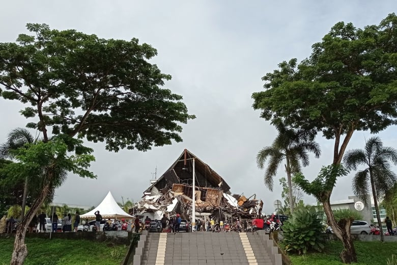 Hotel collapses, at least three dead in Indonesia quake