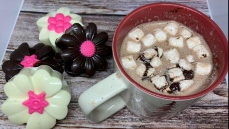 hot chocolate bombs and mug of hot cocoa