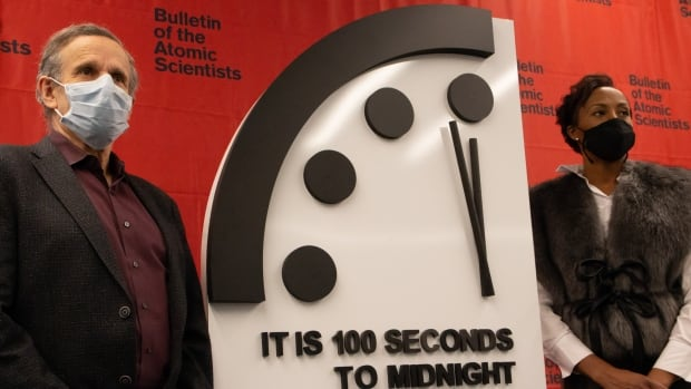Doomsday Clock hovers dangerously close to midnight, as experts warn of 'crossroads' on climate change