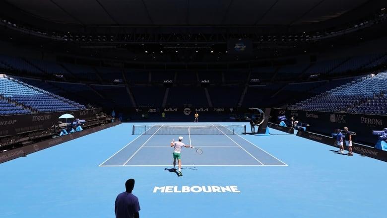 Australian Open build-up disrupted by hotel worker's positive coronavirus test