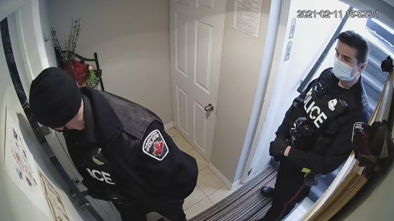 Hamilton police investigating video of officer lunging at woman