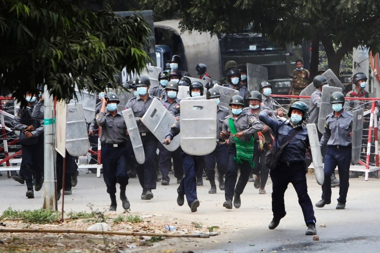 At least 2 protesters killed in Myanmar as police open fire