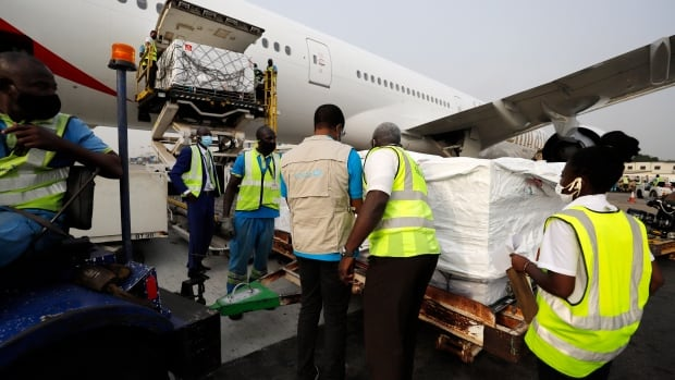 First COVID-19 vaccine doses dispatched by COVAX arrive in Ghana | CBC News