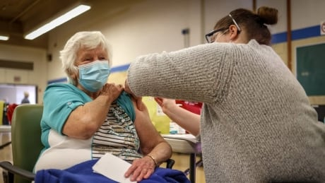 Booking system strained, but Alberta starts vaccinating seniors in latest phase of COVID-19 response