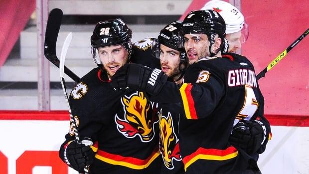 Dillon Dube's hat trick ignites Flames' fireworks in win over Senators