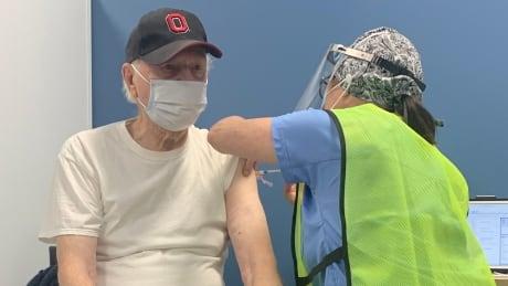 Tom Longeway gets COVID-19 vaccine