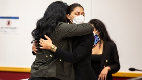 Andrea Sahouri hugs her mother, Muna Tareh-Sahouri